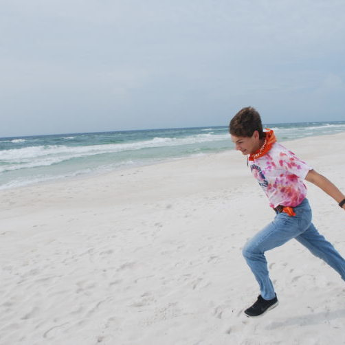 running on the beach | Hybrid Homeschool For Living Science | Living Science Academy